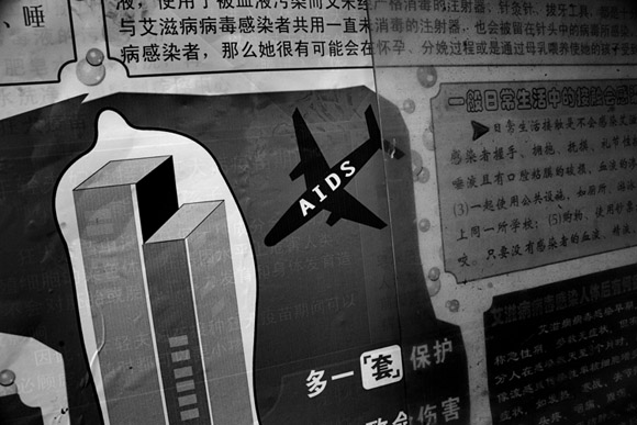 A public health notice in Kunming, Yunnan, China, depicts an airplane representing the AIDS virus running into a skyscraper which is protected by a condom.