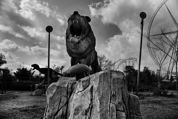 Statues of lions and dinosaurs stand in the middle of a temporary carnival in Grand View Park in Kunming, Yunnan Province, China.