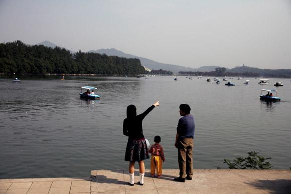 A family looks out over Xuanwu Lake in Nanjing, Jiangsu Province, China.
