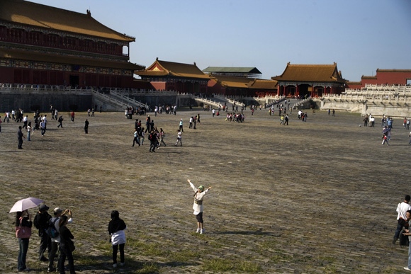 Tourists take pictures in the Forbidden City in Beijing, China.