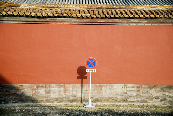 A traffic sign stands against a wall in the Forbidden City in Beijing, China.