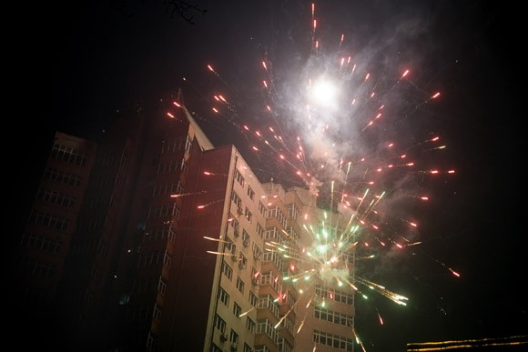Fireworks bounce off highrise apartment buidings during Lantern Festival celebrations in central Haerbin, Heilongjiang Province, China.