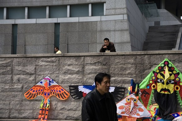 A street vendor sells kites near the Shanghai Science and Technology Museum in Shanghai, China.