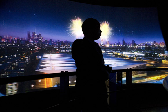 A man watches a panoramic video about the future of Shanghai inside the Shanghai Urban Planning Museum in Shanghai, China.