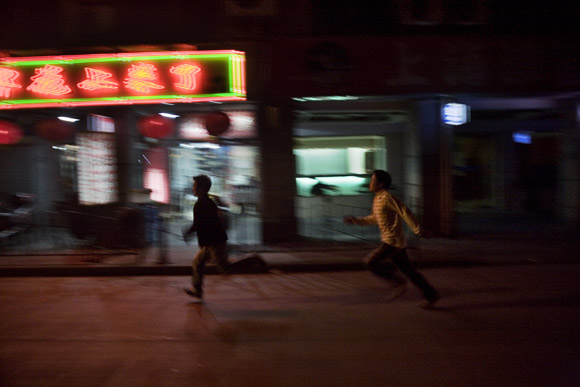 People walk along the streets and alleys around Nanjing East Road in central Shanghai, China.