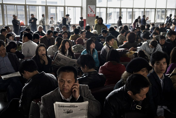 Crowds wait for their trains at the Shanghai Railway Station in Shanghai, China.