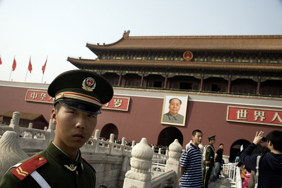Tourists stream into the Tiananmen Gate of the Forbidden City compound in Beijing, China.