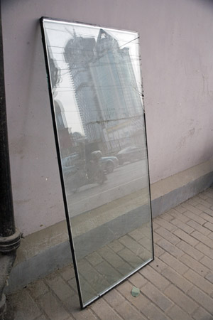 A small pane of glass reflects new development in the Bund area of central Shanghai, China.