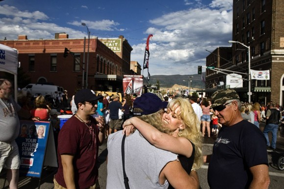 A couple embraces in the middle of a street fair in Butte, Montana, USA.