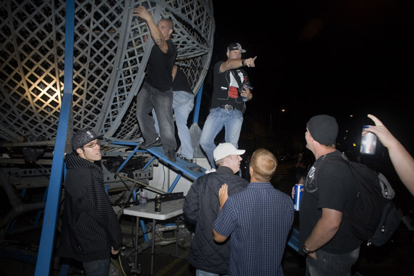 Revelers crowd around a Globe of Death late at night after Evel Knievel Days festivities in Butte, Montana, USA.