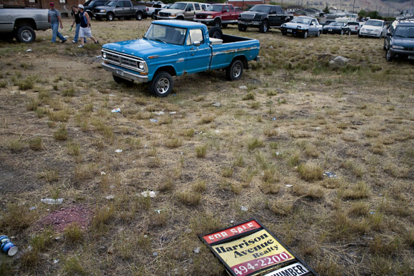A field serves as an impromptu parking lot for Evel Knievel Days in Butte, Montana, USA.
