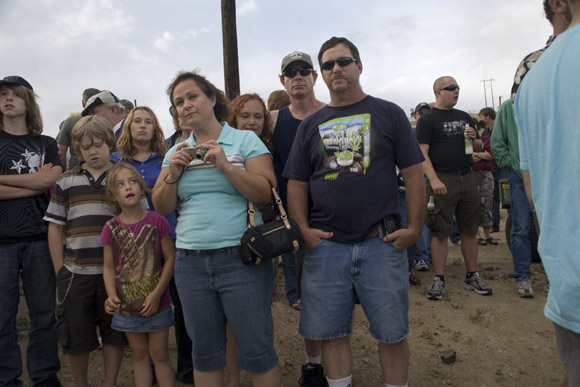 Crowds gather to watch Spanky Spangler's daredevil car jump stunt at the end of Evel Knievel Days in Butte, Montana, USA.