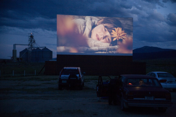 A trailer for Where the Wild Things are is displayed on a drive-in movie theater screen in Butte, Montana, USA.
