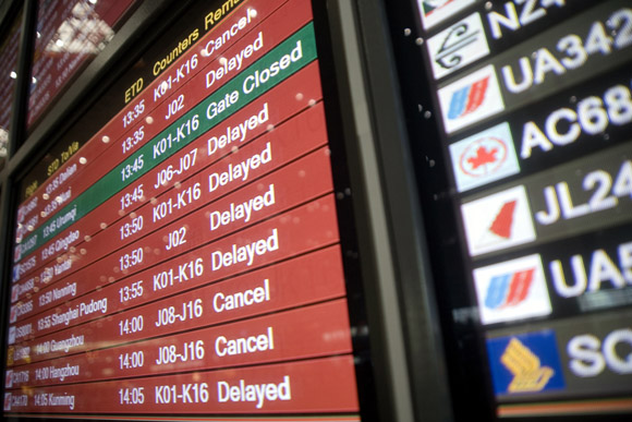 A flight information board displays caanceled and delayed flights at Beijing Capitol Airport Terminal 3 in Beijing, China. Almost all departures and many arrivals were severely delayed or canceled due to thunderstorms and hail in the area.