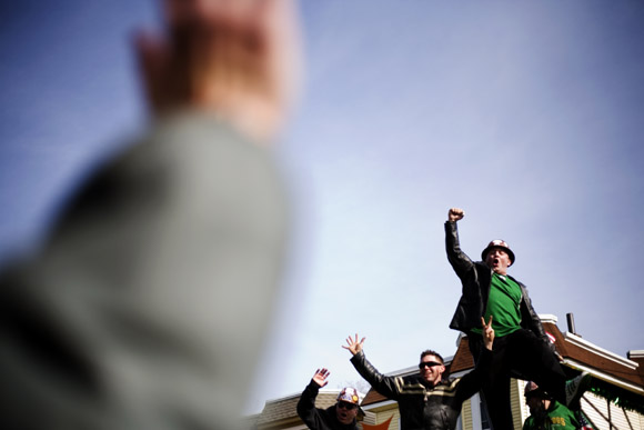 Parade participants interact with the crowd at the St. Patrick's Day Parade in South Boston, Massachusetts.