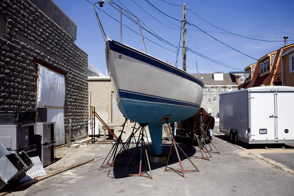 Sailboats stand above ground in dry dock at Newport, Rhode Island, USA.