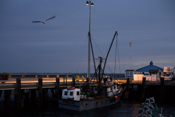 Fishing boats float at docks in Provincetown, Massachusetts, USA.