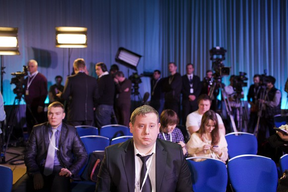 Journalists wait for the arrival of Russian president Vladimir Putin at his annual press conference in Moscow, Russia, on Dec. 20, 2012. The press conference lasted 5 hours.