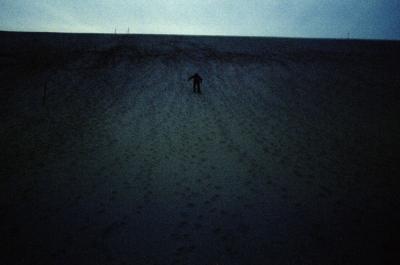 Person climbing sand dunes, Empire, Michigan