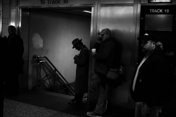 Travelers wait for trains in Penn Station in New York, New York, USA. 2014.